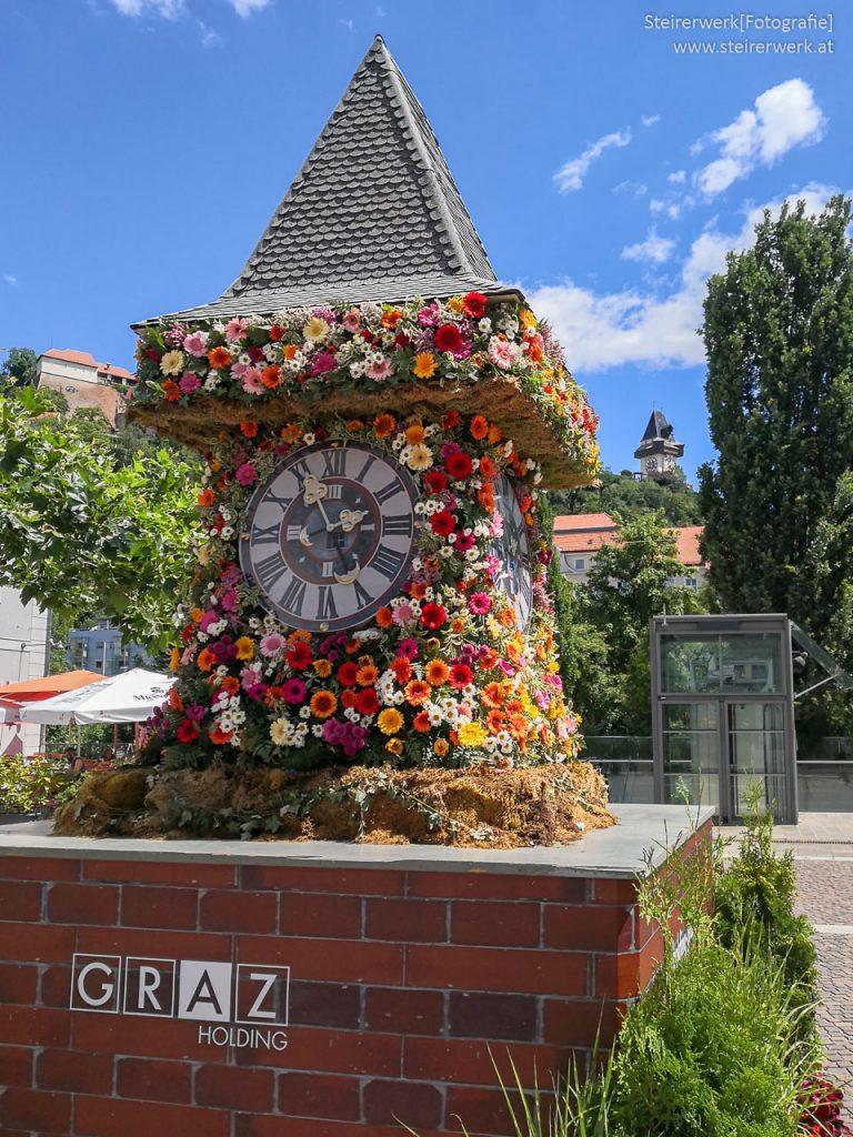 Blumenuhrturm Holding Graz